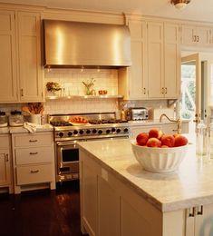 ivory kitchen cabinets with dark floors