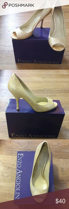 "Enzo Angiolino ""Eamaylie"" peep toe pump Spring is coming so show those toes! Golden ivory colored, snake skin textured peep toe pump with 4"" heel. This is my THIRD pair of these same shoes, as I love the classic style of this pump! Beautiful neutral toned heel that is perfect with dresses and suits a like. Enzo Angiolini Shoes Heels"