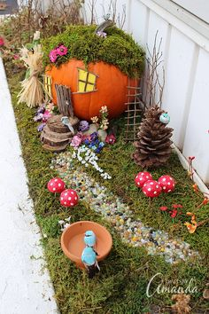 An adorable pumpkin fairy house! Use a pumpkin, natural elements such as twigs and wood, and moss and silk flowers to create a fall themed fairy garden.