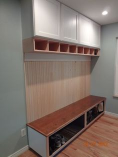 mud rooms in the kitchen | Custom built mudroom bench designed with storage in mind. Built to fit ...