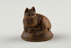 Netsuke of Cat Lying on a Bowl, underneath which is a Fish, 19th century. Japan. The Metropolitan Museum of Art, New York. Gift of Mrs. Russell Sage, 1910 (10.211.2034) #cats