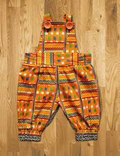romper in African cloth Baby African Clothes, African Dresses For Kids, African Babies, African Children, African Print Fashion, Africa Fashion, African Fashion Dresses, Baby Girl Fashion, Kids Fashion