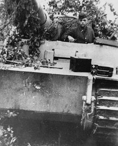 Back from an engagement, this Tiger of the schwere Panzer-Abteilung 502 has received a direct hit from a Soviet 7.62cm tank gun on Leningrad Front in 1943. The round bounced-off leaving only a small indentation without harming the tank crew.   by WW2 Panzer