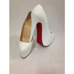 White HOT! These Christian Louboutin Daffodile patent leather sky high platform pumps are a staple shoe for spring or summer! Features a fro...