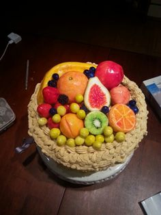 Xavier's 7th b'day cake.I  made it from Red velvet cake with vanilla icing. All fruit is made from icing.