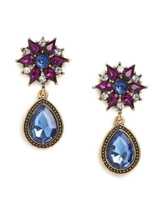 Talk about a spectacular statement stunner. This is one audacious style - just check out that dramatic floral-like cluster of crystals, the oversized teardrop gems and the rich palette of pretty blues and purples.