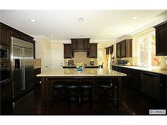 Dark cabinets, light countertops, stainless steel appliances