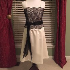 SALEWhite House Black Market cocktail dress Beautiful black lace over off white fabric,with ribbon belt.can be worn with or w/o straps.also there is a flare where the belt is,see pic # 3.Size 4In good condition,no stains,fully lined,back zipper.❌❌NO TRADES❌❌ White House Black Market Dresses