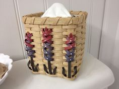 A cubey tissue basket with lupine flowers made from the transition pieces of space dyed reed