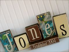 Mod podge scrapbook paper on blocks and add family name.