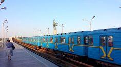 At the Dnipro Metro platform. Ukrainian colours adorn a Soviet-era subway train.