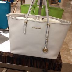 Love the white micheal kors bag