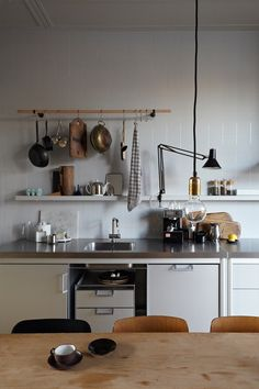 Stef Bakker // Apartment // white; stainless steel; utility rack; task light; pendant; tiled splashback; shelf; eat in