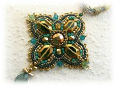 Greengold bead embroidered necklace and earrings  by budaikata, $100.00