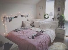 This bed looks super comfy and I like the bedside table and kinda the plants