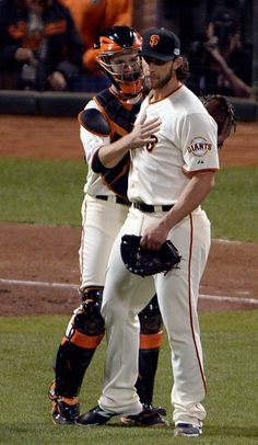 San Francisco Giants' Buster Posey (28) congratulates San Francisco Giants pitcher Madison Bumgarner (40) after winning 5-0 over the Kansas City Royals at the end of Game 5 of baseball's World Series against the Kansas City Royals at AT&T Park in San Francisco, Calif., on Sunday, Oct. 26, 2014. (Jose Carlos Fajardo/Bay Area News Group)