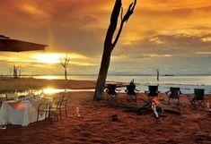 A great dinner evening on the Lake Kariba bank at Bumi Hills with Victoria Falls Safaris. Travel Deals, Us Travel, Victoria Falls, Zimbabwe, Lodges, Wind Turbine, Highlight, Safari, Cruise