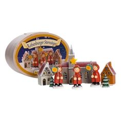 Käthe Wohlfahrt original design; hand-painted wooden figurines, church and houses. Eight-piece set of carolers in red capes singing as they walk through the village. Packaged in a decorative wooden box. $54.95  -I love the figures carrying latanas :)