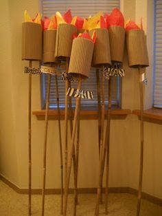 fake tiki torch's made with tissue paper | Don't Cook Or Clean: How to Throw a Survivor Themed Party