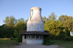 9. Old ice cream store, MA and RI border on Route 146. This milk jug shaped building is slowly being consumed by nature and is quite the sight.