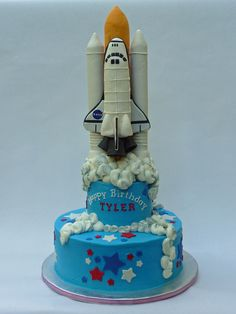 3,...2,..1,.. Ignition, ... We are go for Space Shuttle Birthday Cake! - Space Shuttle cake.  Packed RKT rockets, fuel tank, and space shuttle covered in MMF details.  Each shuttle component was hand sculpted after using PVC pipe to compact the RKT into a tubular shape while cinching a dowel in the center.  Allowed RKT to airdry to stiffen as much as possible prior to carving and covering.  There is a central PVC and platform support system to support the shuttle 1/2in above the top tier ...