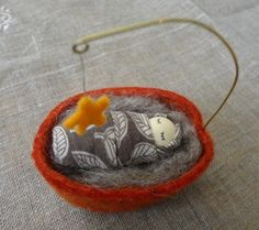 tiny baby in cradle with star suspended overhead. Waldorf Crafts, Waldorf Toys, Holiday Crafts, Christmas Crafts, Christmas Ornaments, Wet Felting, Needle Felting, Walnut Shell Crafts, Crafts For Kids