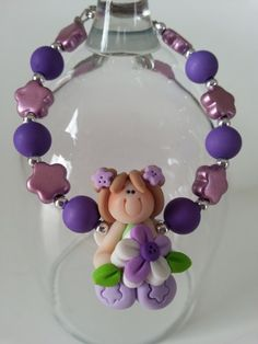 Here is a special gift to offer for children anniversary, Valentine's day. A bracelet made with fimo baby doll, metallic beads and acrylic beads in purple and lilac colors. Lenght: 6 inches * I may Purple Necklace, Purple Jewelry, Aluminum Wire Jewelry, Valentine Day Gifts, Valentines, Lilac Color, Fashion Mode, Acrylic Beads, Little Gifts