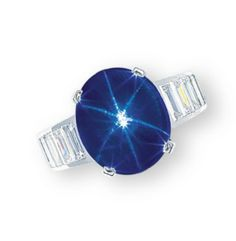 A STAR SAPPHIRE AND DIAMOND RING, BY CARTIER  Set with a cabochon star sapphire, to the baguette-cut diamond three quarter-hoop, mounted in 18k white gold, ring size 5, with French assay mark for gold, in red leather Cartier case