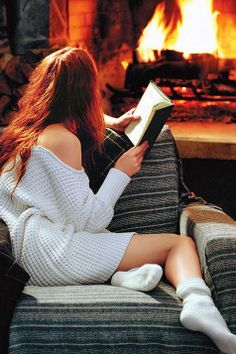 Reading by the fireside in a armchair