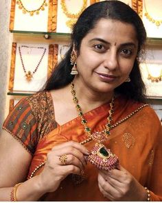 Actor Suhasini wearing one of the antique pieces on display at the exhibition in Chennai on Friday. — Photo: S.S. KUMAR