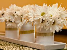 Coffee cans + spray paint + washi tape = #DIY spring decor.