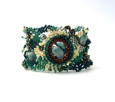Beaded jewelry. Green, cream freeform peyote cuff bracelet, unique gifts idea, womens fashion. $78.00, via Etsy.