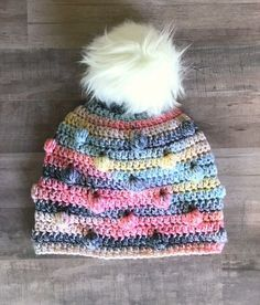 I am in love with this free crochet hat pattern. The bobbles add just the right texture and the fluffy fur pom tops it off perfectly. The ha...