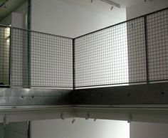 Steel rail with wire mesh infill