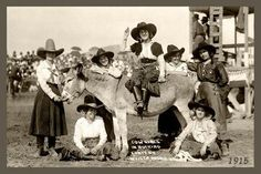 Group of rodeo cowgirls and a donkey. This is a vintage Doubleday photograph taken circa 1915