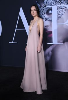 A breathtaking Dakota Johnson wore a Valentino Spring/Summer 2017 crepe couture dress by Pierpaolo Piccioli to the 'Fifty Shades Darker' Premiere in Los Angeles.
