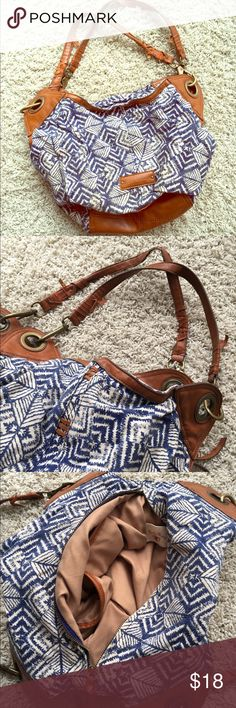 Slouchy Lucky Brand bag This has a fabulous print. It's a slouchy bag that can hold all of your treasures. It's leather, linen and cotton. Feels like canvas. Zippers work. Inside pockets for phone, etc. the straps are a little frayed as pictured, but it's still in good condition! Offers welcome. Lucky Brand Bags Shoulder Bags