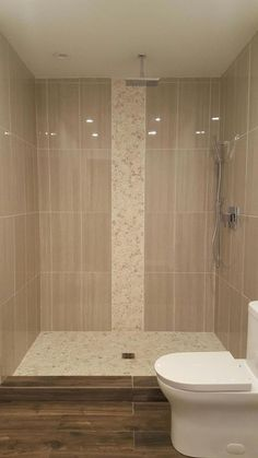 Shower flooring tile extending into vertical accent strip