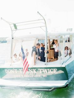Getaway boat for lake wedding - The Wedding Story of Hailey and Dustin Drost | WeddingDay Magazine