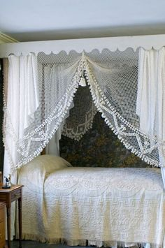 A lacy bower for sleeping! I wonder if something similar could be created by tucking the bed into an alcove, and draping a crochet tablecloth from the ceiling?