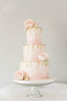 Blush and gold drip wedding cake with watercolour details and sharp edges