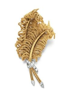 A GOLD AND DIAMOND FEATHER BROOCH, BY MARCHAK