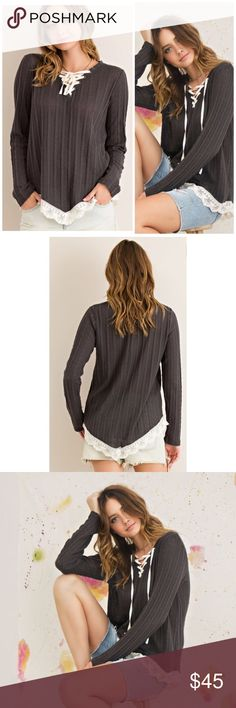 Lace Up Sweater Solid cut and sew sweater top featuring V-silhouette neckline with lace-up detail. Edge lace detail on V-shape hemline. Non-sheer. Knit. Color Grey  65%POLYESTER 35%COTTON Threads & Trends Sweaters