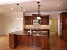 Traditional Medium Wood-Cherry Kitchen Cabinets - from Kitchen-Design-Ideas.org undefined