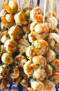 Easy and delicious grilled shrimp skewers loaded with pesto sauce, garlic, and lemon