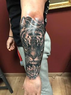 Realistic Tiger and Lotus Flower in Black and Gray Tiger Forearm Tattoo, Tiger Tattoo Sleeve, Lion Tattoo, Grey Tattoo, Sleeve Tattoos, Leg Tattoos, Black Tattoos, Body Art Tattoos, Tattoos For Guys
