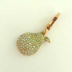 Juicy Couture Pear Charm So sparkly! New in tagged box. Never worn. Mint condition. Juicy Couture at its best! Super Rare Charm. Juicy Couture Jewelry