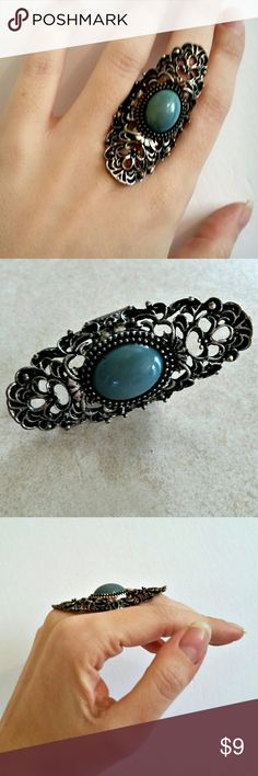 """Silver Filigree Emerald Jade Full Finger Ring Awesome eye-catching costume ring. Faux tarnish finish ages the silver-colored ring. Intricate, vintage-inspired filigree design. Ring is elastic and will fit most fingers. Stone is a pretty emerald-jade shade. Unusual, unique, with a versatile style that is equally grunge, goth, and Victorian. So fun to wear.  Height - 2.5"""" Width - 1"""" Weight - .4 oz  Color may vary slightly based on screen display.  #ring #fullfinger #fullfingerring…"""