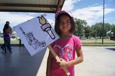 """Protesting the detention of Central American migrants, seven-year-old Paikea Marquez said she came to support the detainees. """"We should let them out, because they're getting killed"""" in Central America, she said."""