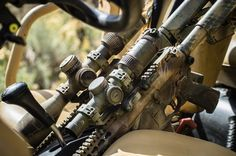 A couple of AR's riding shotgun. Ironic?  - - - Big brother and little brother Razor Gen II's all painted up and ready for action.  - @tacgas_fuelyourbrand - - - - - #VortexNation #VortexOptics #RazorHD #Camo #Tactical #RAZR #Badass #Offroad #Guns #SickGuns #WeaponsDaily #IGMilitia #SecondAmendment #AR15 #AR10